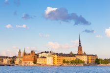 Panoramic view of swedish capital Stockholm in sunset. Gamla stan, old medieval downtown. Horisontal composition. Copy space.